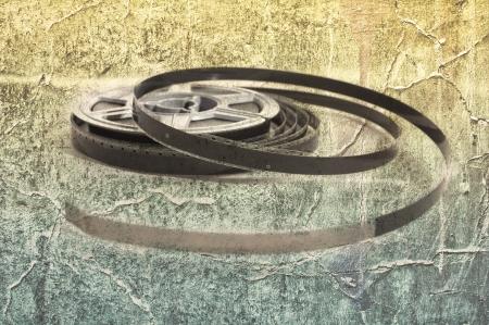 kine: Still life of 8mm cine film reels over a grunge background Stock Photo
