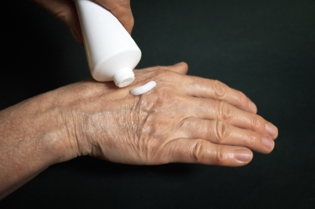 Cream for hands, over a dark background  Cosmetic, medicine concept