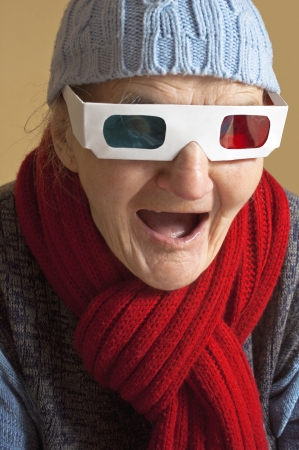 Elderly woman with anaglyph 3D glasses making shocked face