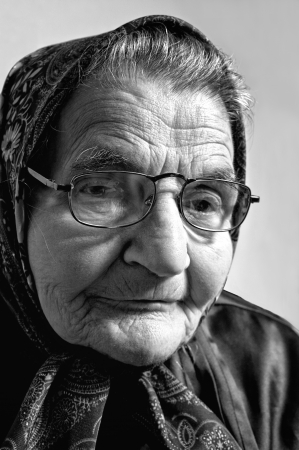 Black and white portrait of an elderly woman  Dreaming the past