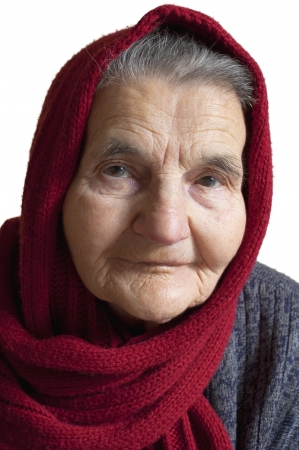 Portrait of an elderly woman with  red scarf on head photo