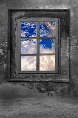 Old window in a cold concrete room, view on cloudy sky  Stock Photo - 18441410