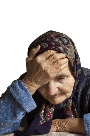 Portrait of a sad elderly woman holding her head in pain   Stock Photo