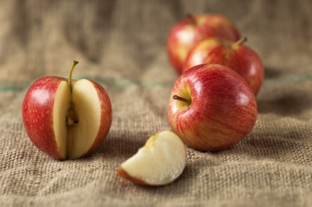 Tasty red apples whit slice on table Organic food production
