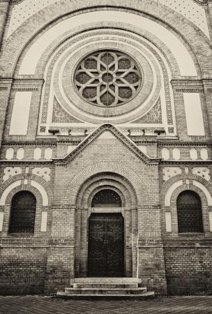 Big wooden entrance door at synagogue in Novi Sad, Serbia