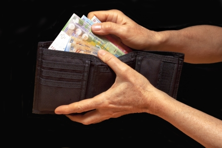 Black wallet with money in hands  Swiss francs banknotes  photo