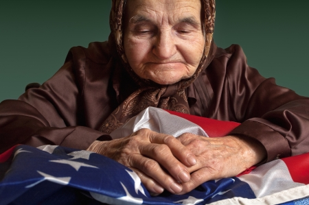 Old woman holding an American flag  Stock Photo