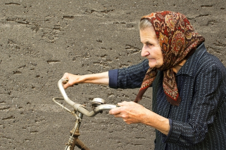 Active elderly woman with her bike