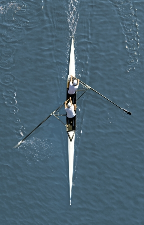 Two man rowing in kayak down the river  photo