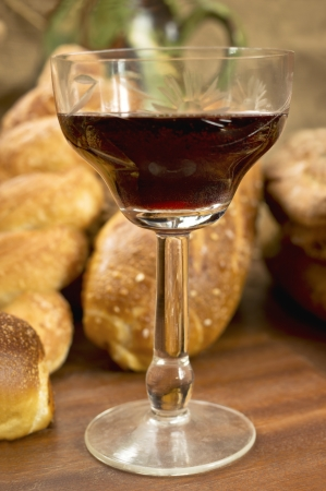 Still life assortment of bread with a glass of red wine  Selective focus on glass of red wine  Stock Photo