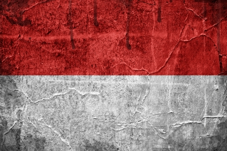 Flag of Monaco overlaid with grunge texture