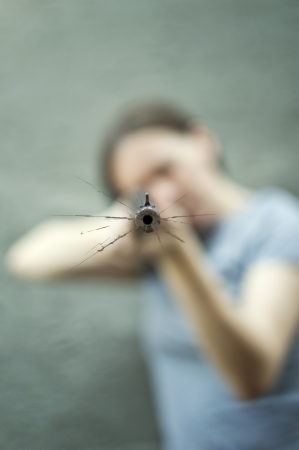 Woman with a rifle. Selective focus on the barrel. Stock Photo