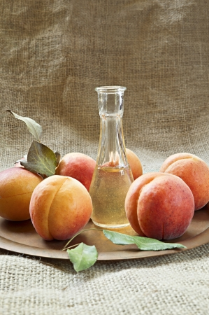 Fresh and tasty apricot fruit and apricot brandy on a plate