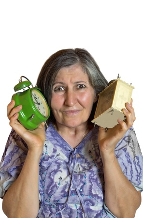 Portrait of shocked woman with two alarm clock over white background  photo
