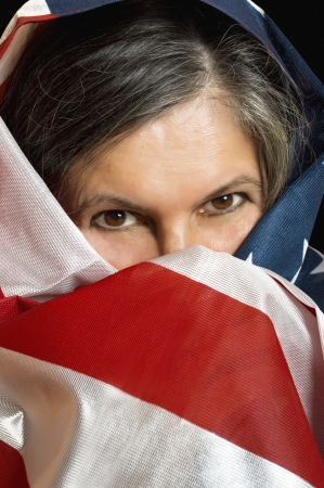Adult woman wrapped in a United States flag  photo