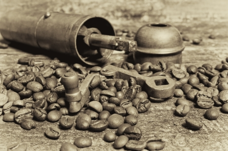 Coffee beans with coffee grinder on wooden table  Vintage style
