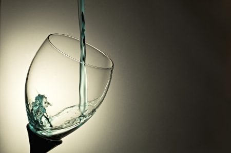 Blue water splash in glass Stock Photo