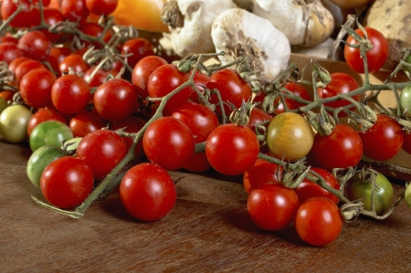 Red cherry tomatoes on wooden table  Organic food and dieting concept