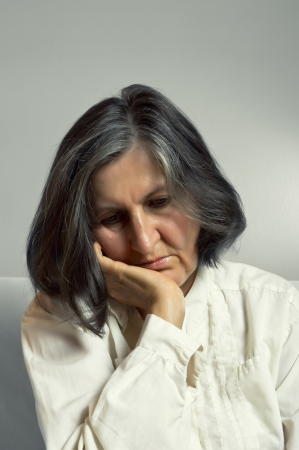 middle adult: Portrait of sad lonely pensive middle aged woman.