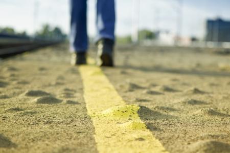Person walking on asphalt road