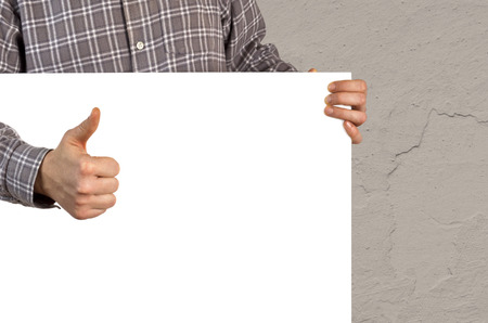 Person with white blank board showing thumb up
