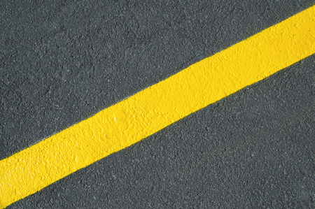 Yellow line on new asphalt detail