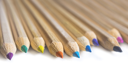Color crayon pencils isolated on white background. Shallow depth of field.
