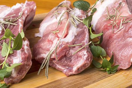 Piece of fresh raw meat on cutting board. Stock Photo