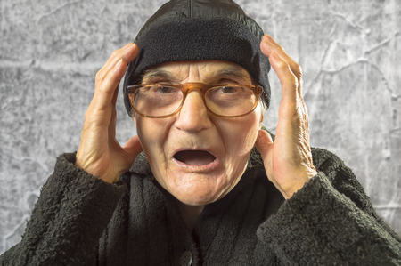 woman screaming: Portrait of scared and worried elderly woman.