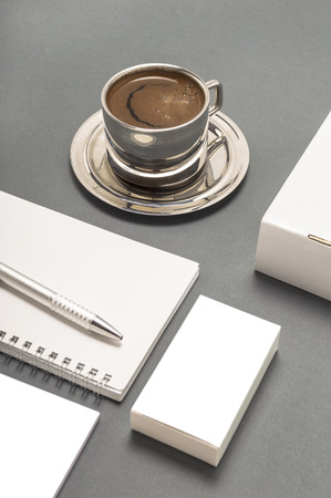 Blank stationery set : coffee cup, business cards, booklet, sheets, notebook, CD, boxes and pencil.