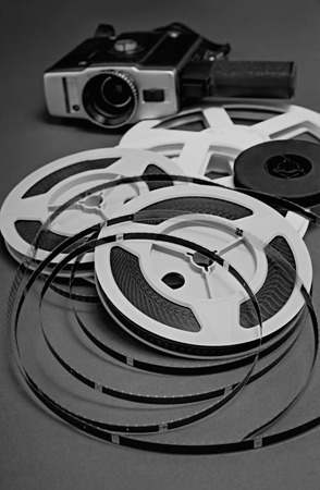 Still life of 8mm cine film reels and old movie camera. Shallow depth of field.