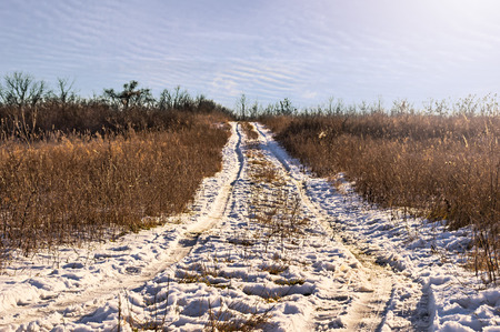 Empty snow covered road in winter landscape. Stock Photo