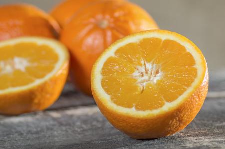 Orange fruit on brown wooden background
