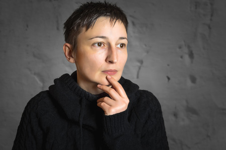 wondering: Portrait of worried woman. Thinking and wondering concepts. Stock Photo