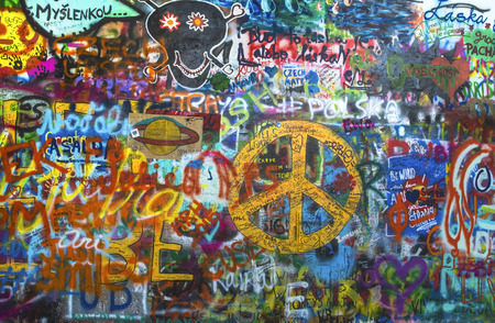 lyrics: PRAGUE, CZECH REPUBLIC - JUNE, 2015: Lennon Wall is filled with John Lennon-inspired graffiti and pieces of lyrics from Beatles songs.