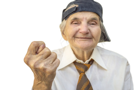 scrooge: Elderly woman showing fig sign. Selective focus on hand