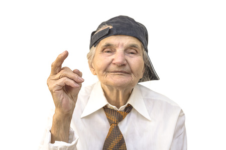 Elderly woman with cap showing middle finger. Selective focus. Stock Photo