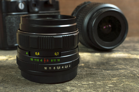 camera lens: Camera lenses on wooden table. Selective focus.