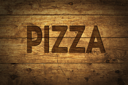 Grunge wood with text Pizza. Stock Photo