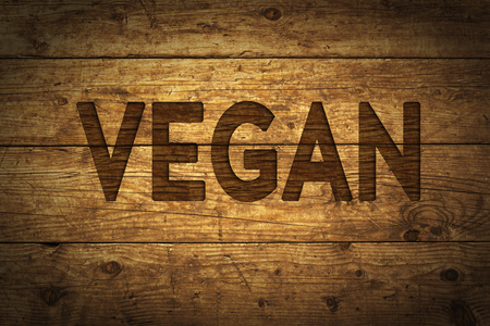 Grunge wood with text Vegan.