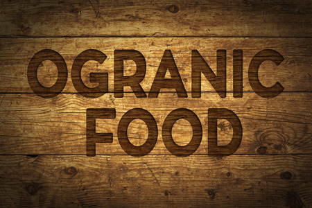 Grunge wood with text Organic Food. Stock Photo