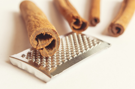 cinnamon sticks: Close-up of fragrant cinnamon sticks and grater. Selective focus.