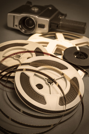 cine: Still life of 8mm cine film reels and antique super 8mm movie cinema camera Stock Photo