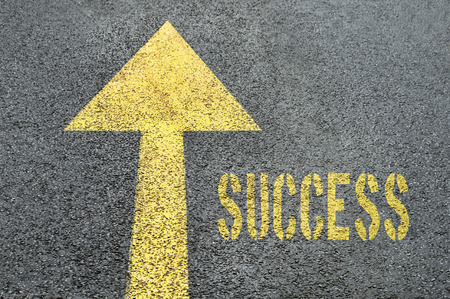 surpassing: Yellow forward road sign with Success word on the asphalt road. Business concept. Stock Photo