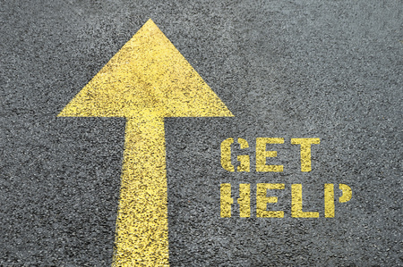 get help: Yellow forward road sign with Get Help word on the asphalt road. Human rights concept. Stock Photo