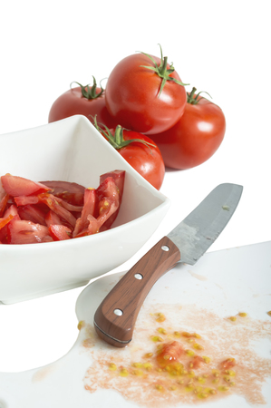 Chopped tomatoes and knife on cutting board. selective focus.
