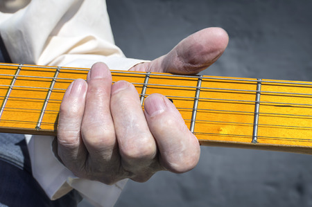 Woman hand playing electric guitar. Selective focus.