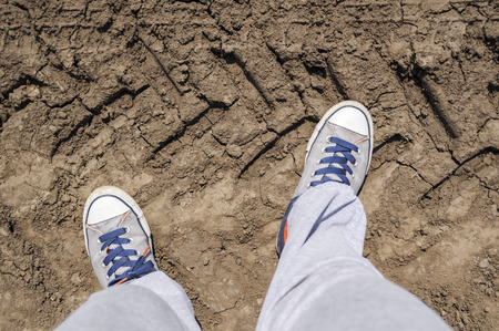 Top view of sneakers on a very dry terrain. Stock Photo