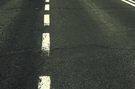 White grunge line on asphalt road.