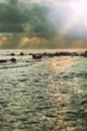 The storm over the sea at sunset, blur image. Stock Photo